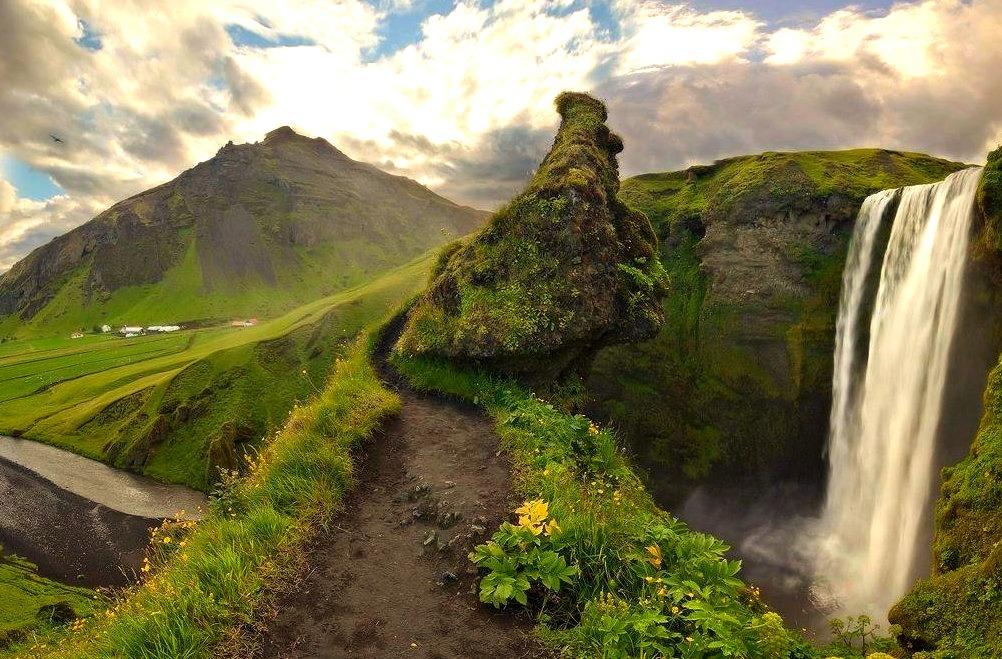 Giant guarding Skogafoss Waterfall, Iceland