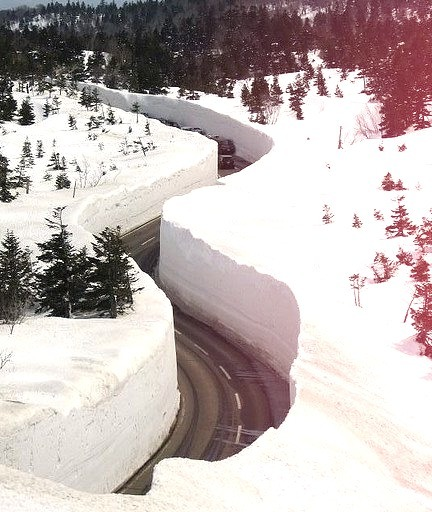 Giant snow walls on Hakkoda Walk, Japan