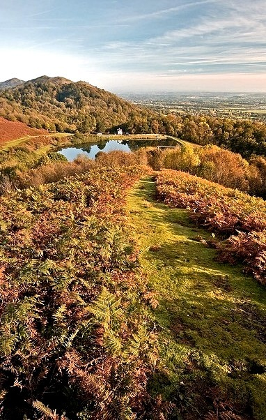 Grassy path leading down the hills to the reservoir, Malvern Hills / England